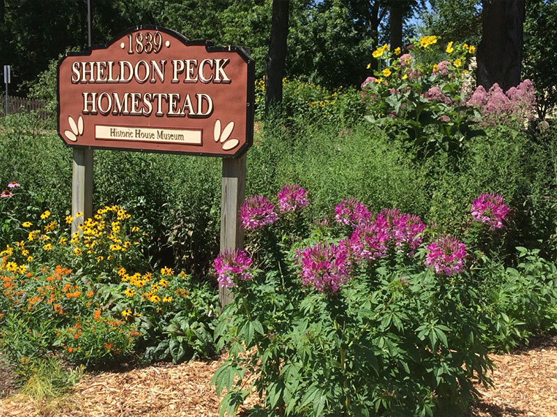 The Peck Homestead Garden sign